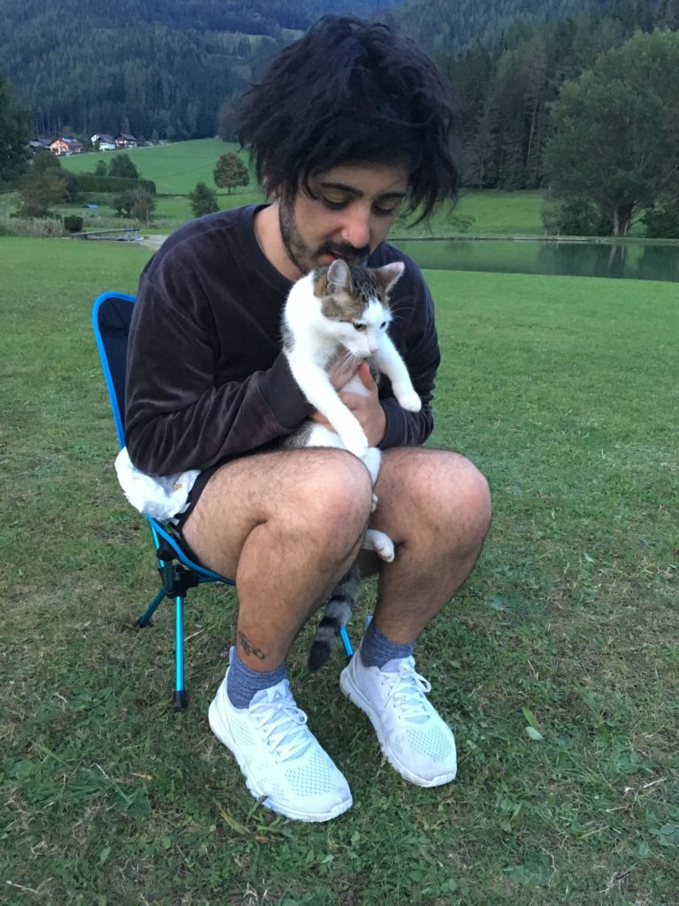 Aydin holding the campsite kitty