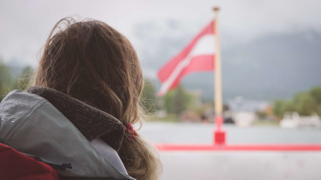 Caroline on the ferry to St Wolfgang with the Austrian flag blowing in the breeze