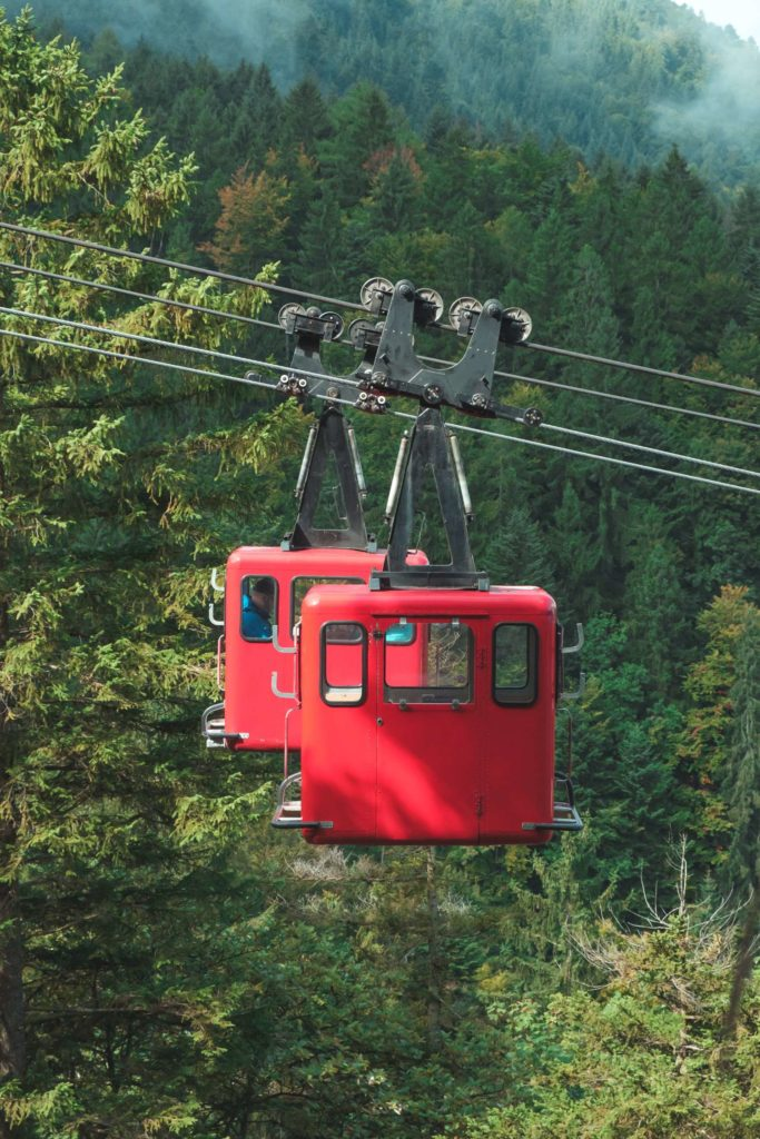 Red cable cars near St. Gilgen