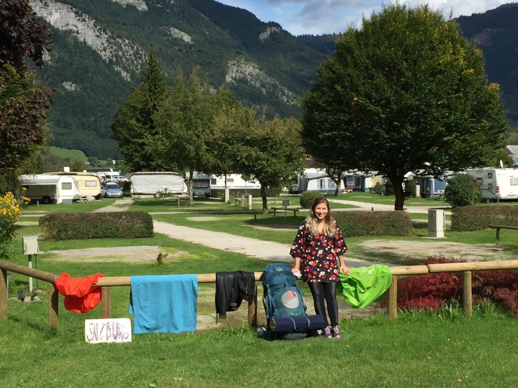 Caroline posing with camping gear which has been hung out to dry at the Wolfgangsee campsite