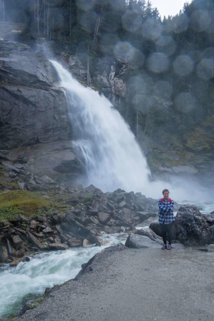 Caroline standing in front of Krimml waterfall getting very wet
