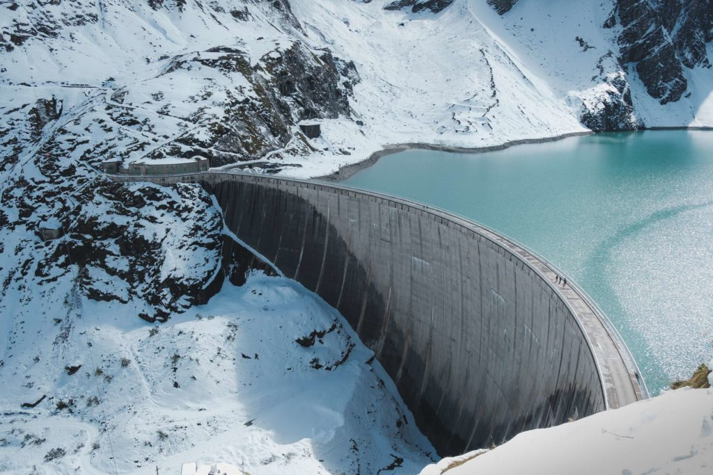 Mooserboden dam wall surrounded by snow