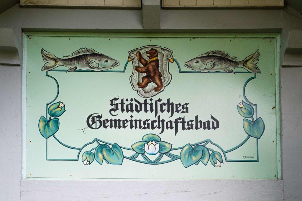 """Sign at Drei Weieren in St. Gallen saying """"Städtisches Gemeinschaftsbad"""" - communal bath"""
