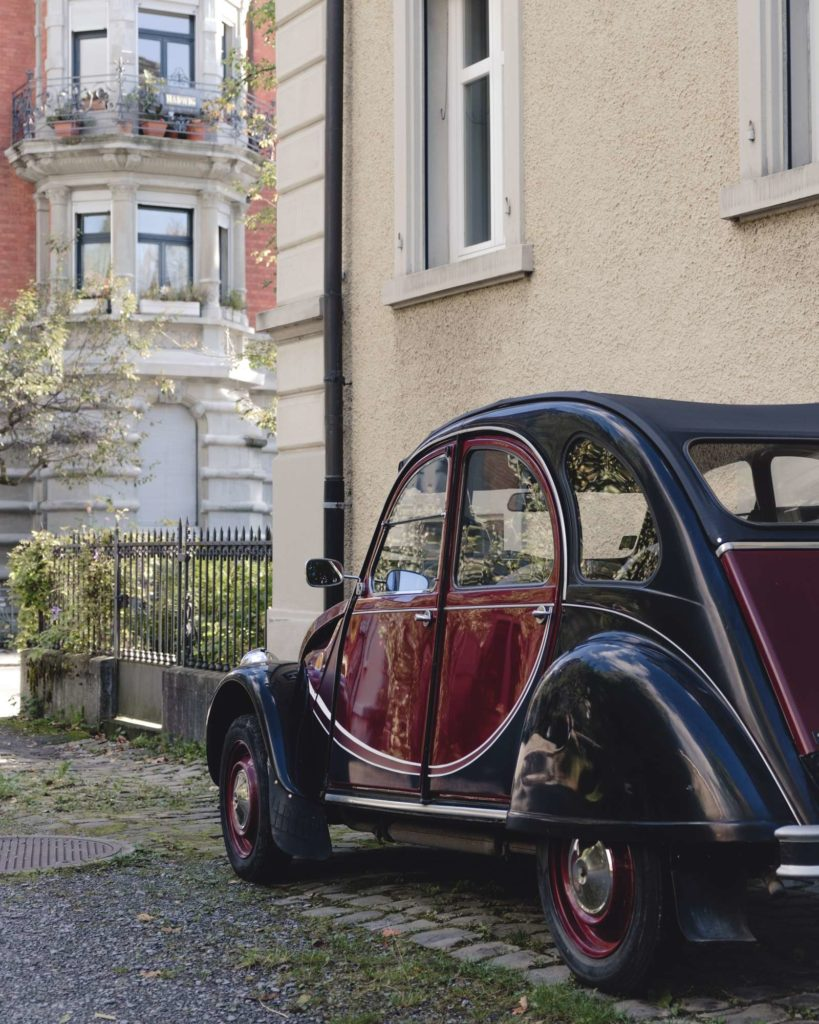 Red and black Käfer vintage car in St. Gallen