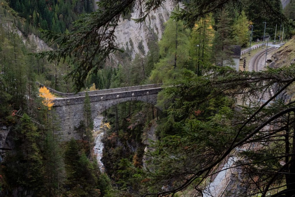 An old bridge and train station in the canyon on the Glacier Express