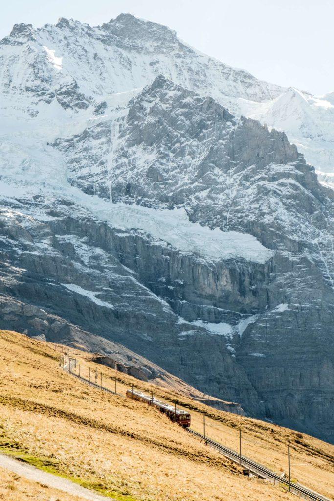 Jungfrau train with huge snowy peak towering over