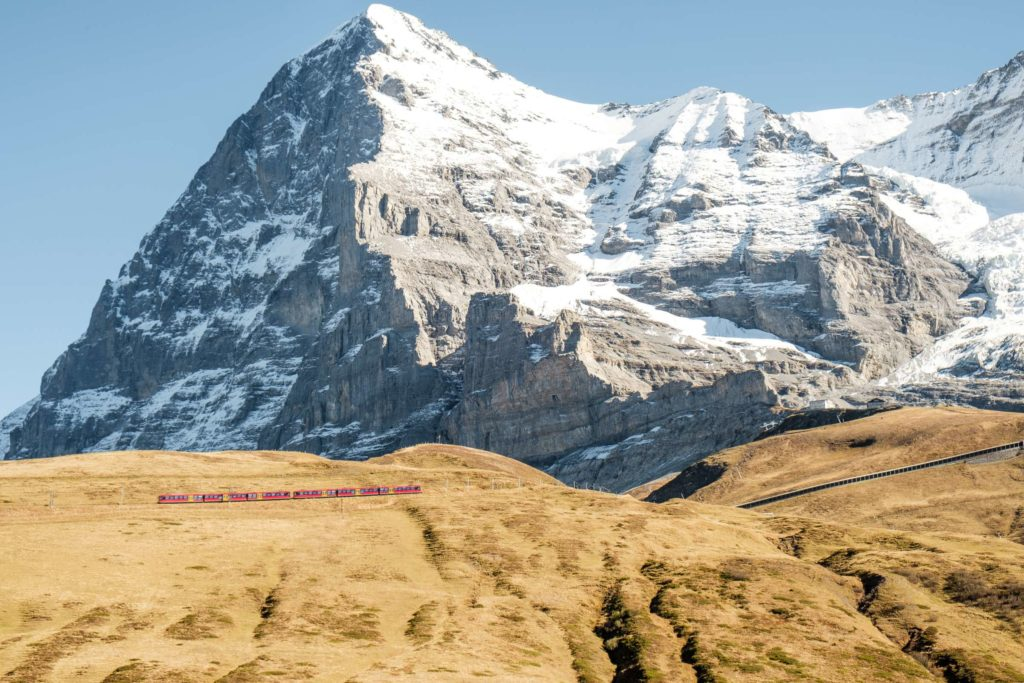Jungfrau train with huge mountains behind it