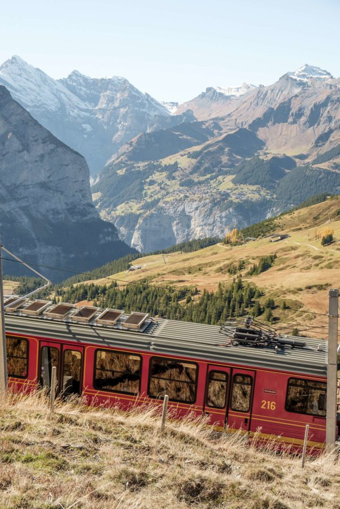 A view of Mürren with the Jungfrau train passing in the foreground