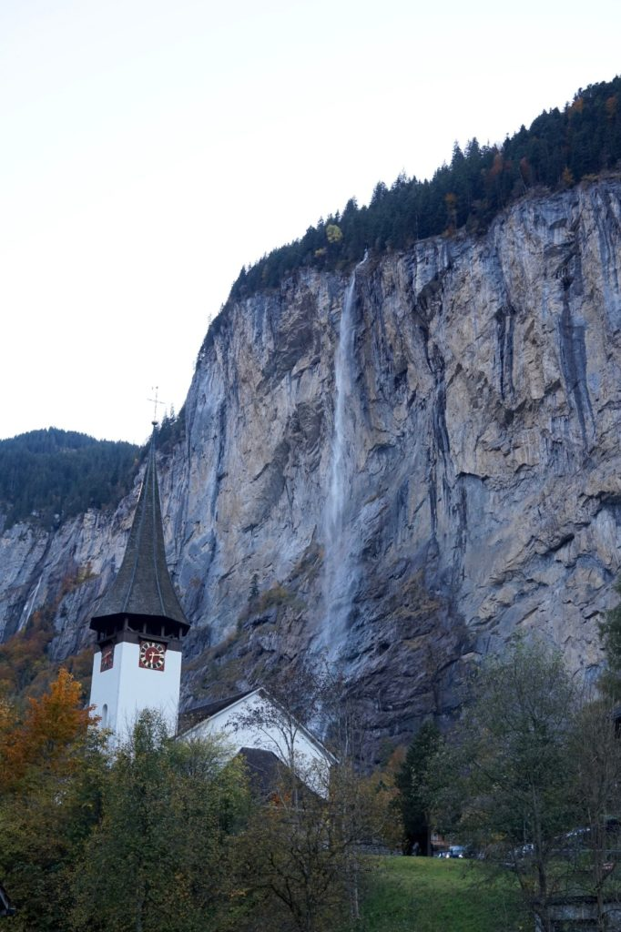 Staubbach waterfall with church in foreground