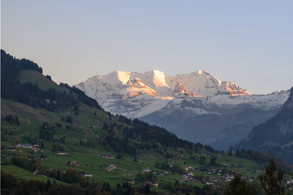 The Sunsetting over Jungfrau with a cute alpine village in the foreground