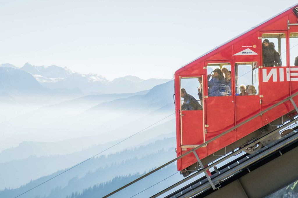 Super closeup of the Niesenbahn with people looking out the windows