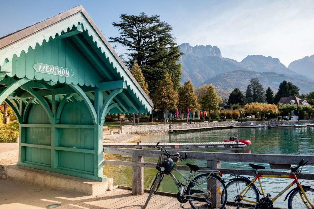A cute turquoise wooden archway on a boardwalk to lake Annecy