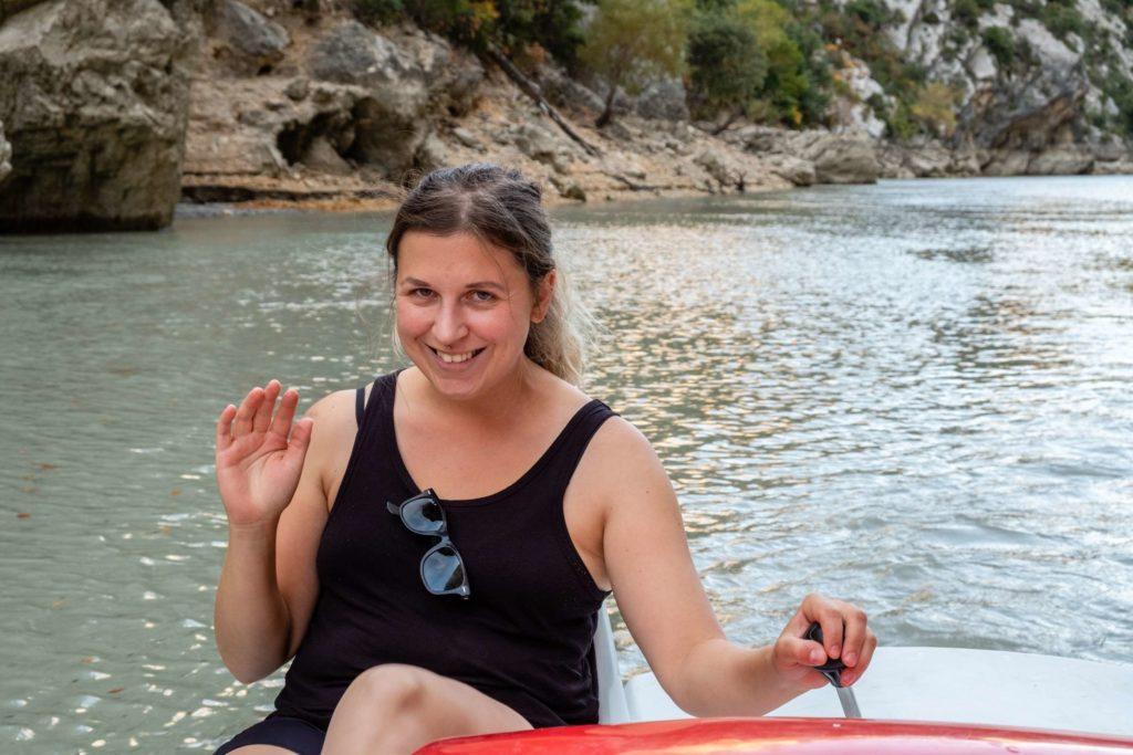 Caroline waving on paddle boat