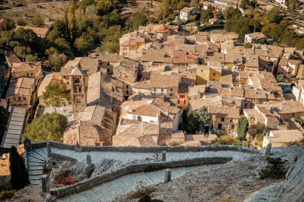 Moustiers-Sainte-Marie from above with winding path to church
