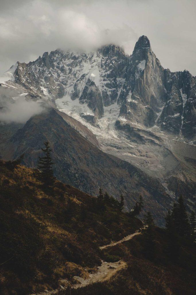 Winding path way to towering peaks of Mont Blanc