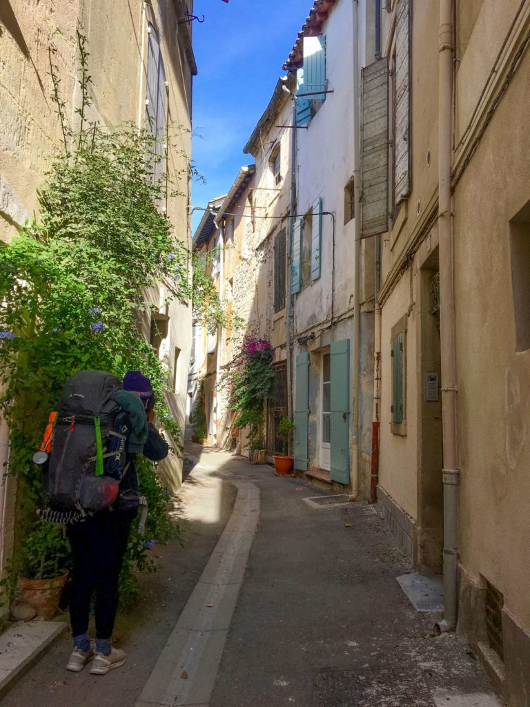 Aydin photographing side street in Arles