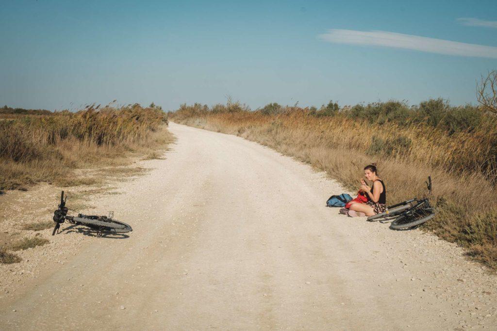 Caroline eating lunch during a bike ride break