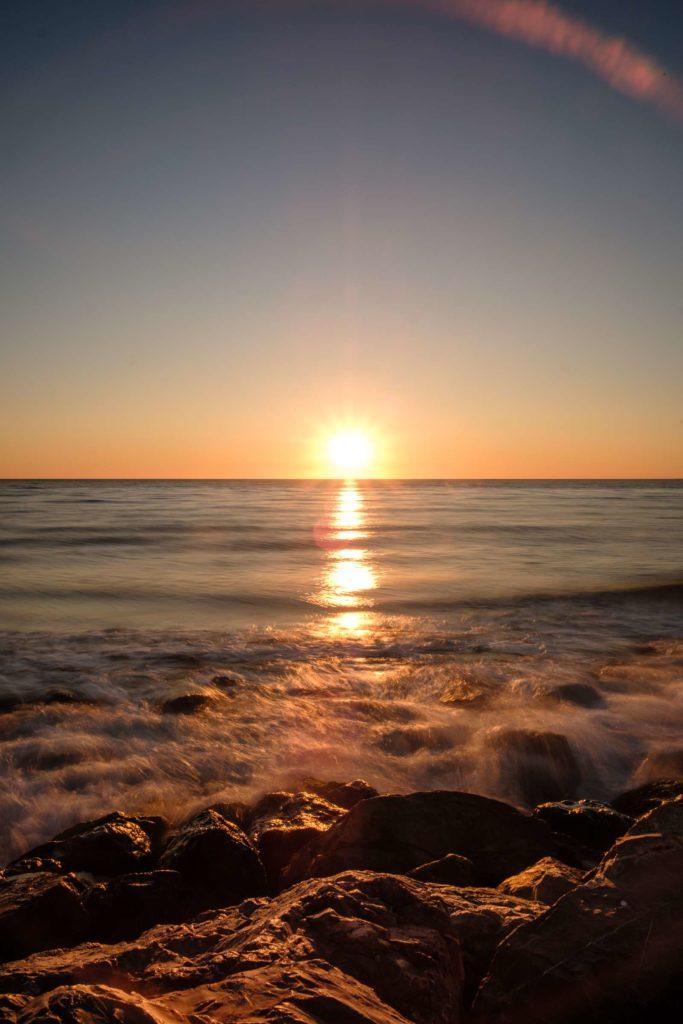 Camargue sea sunset over rocks