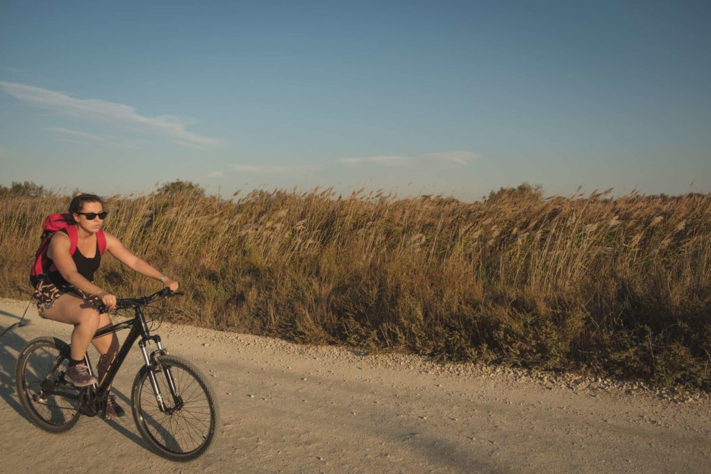 Caroline speeding through the Camargue on her bike