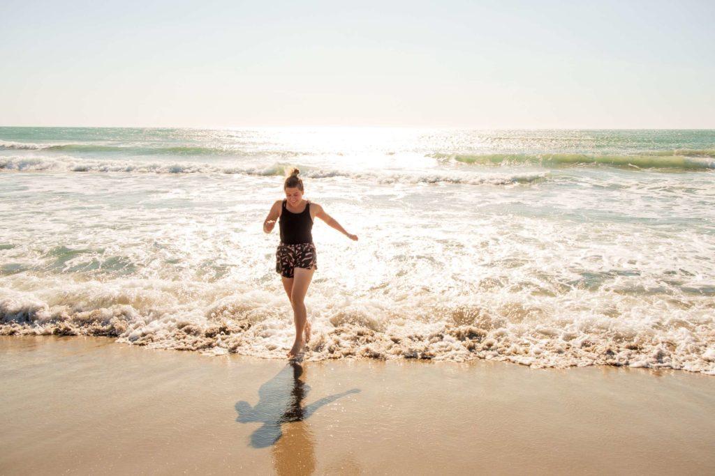 Caroline running on the beach