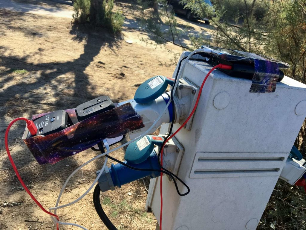 Charging devices at the campsite with duct tape