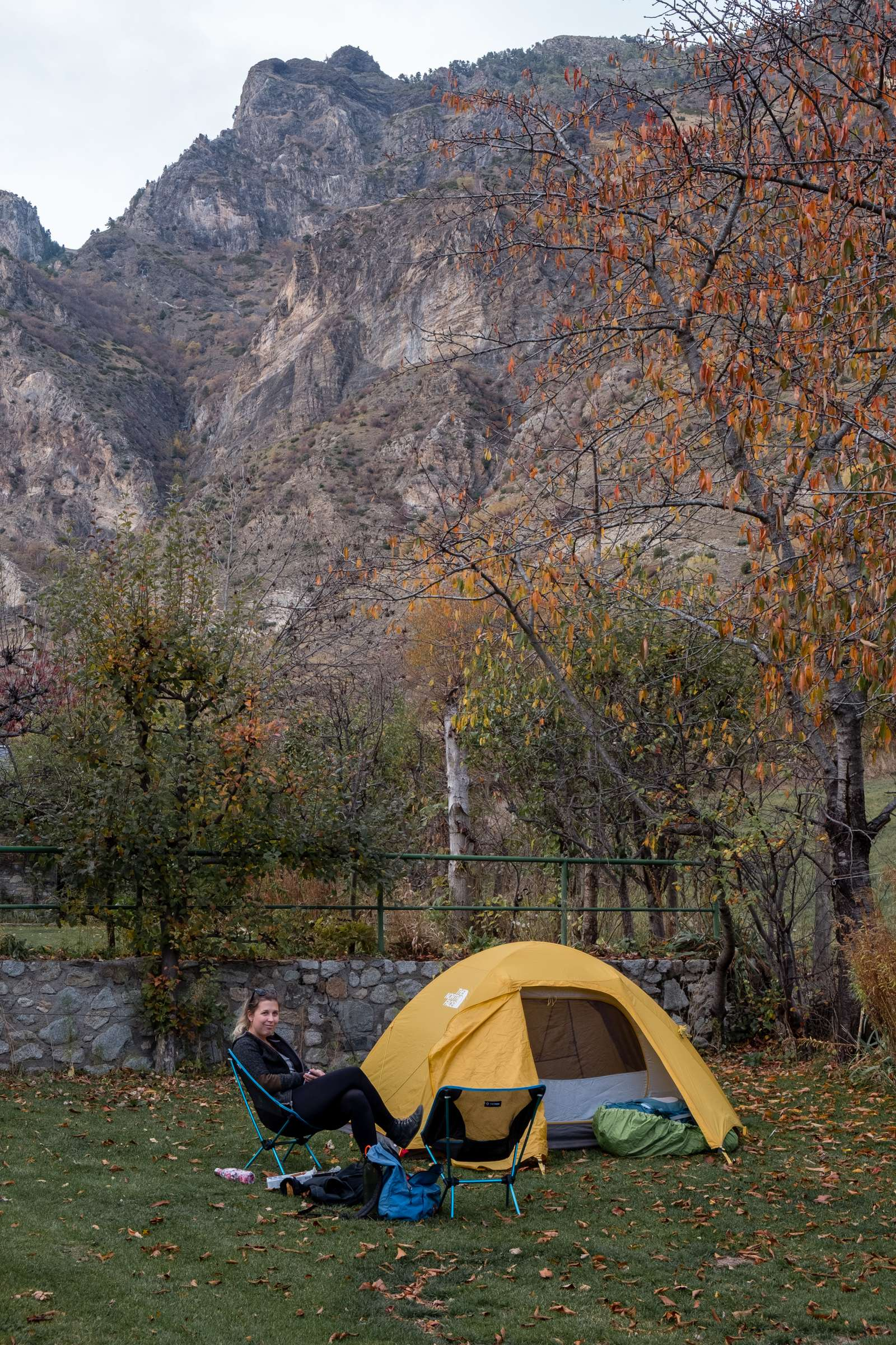 Caroline sitting on our Espot campsite pitch in the Pyrenees
