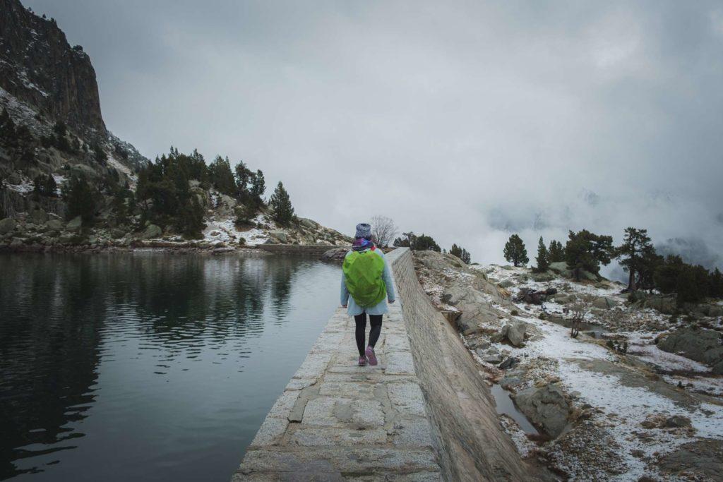 Caroline walking along lake Estany Gran d'Amitges