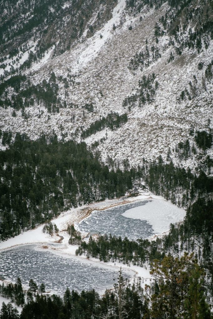 Two frozen lakes from above in Aigüestortes i Estany of Saint Maurici national park
