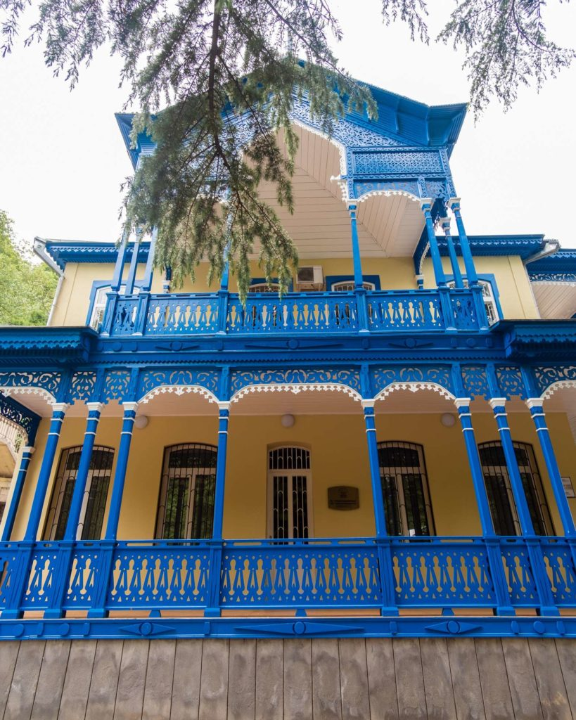A beautifully restored yellow and blue building in Borjomi