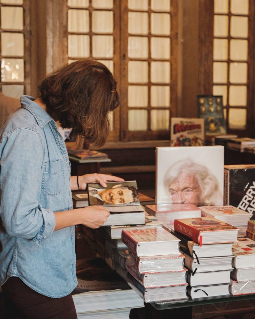 A lady reading a book in Livraria Lello