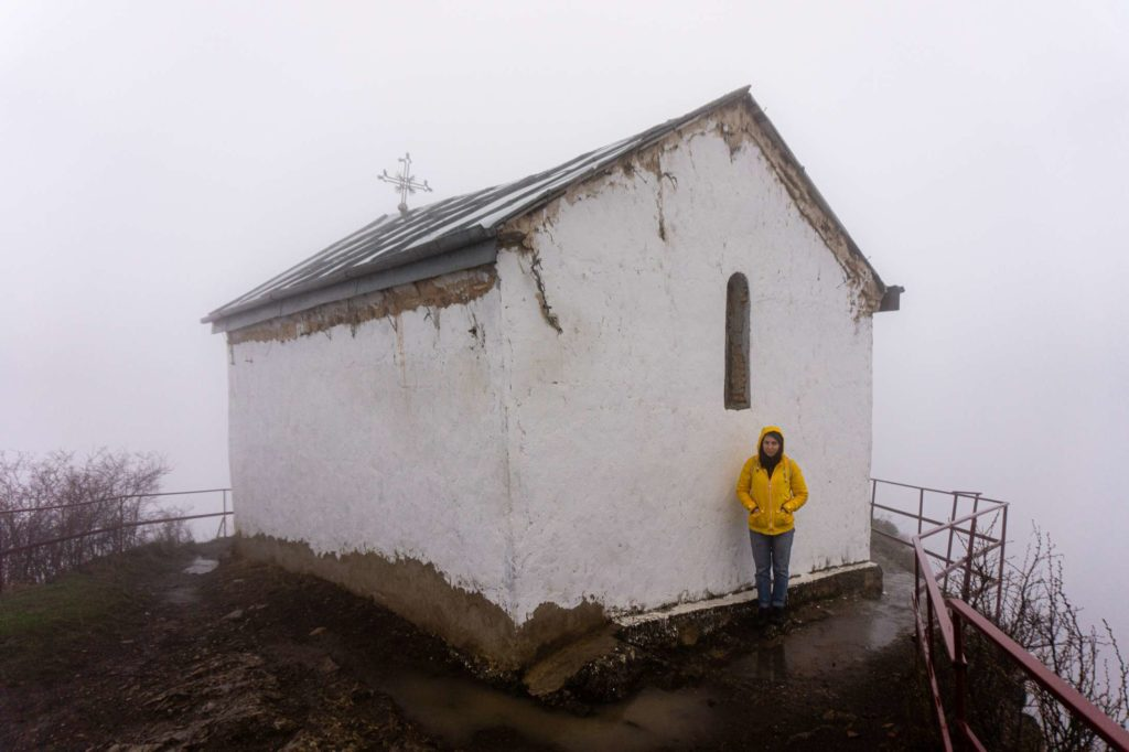 Caroline standing next to Tsveri church in the thick fog