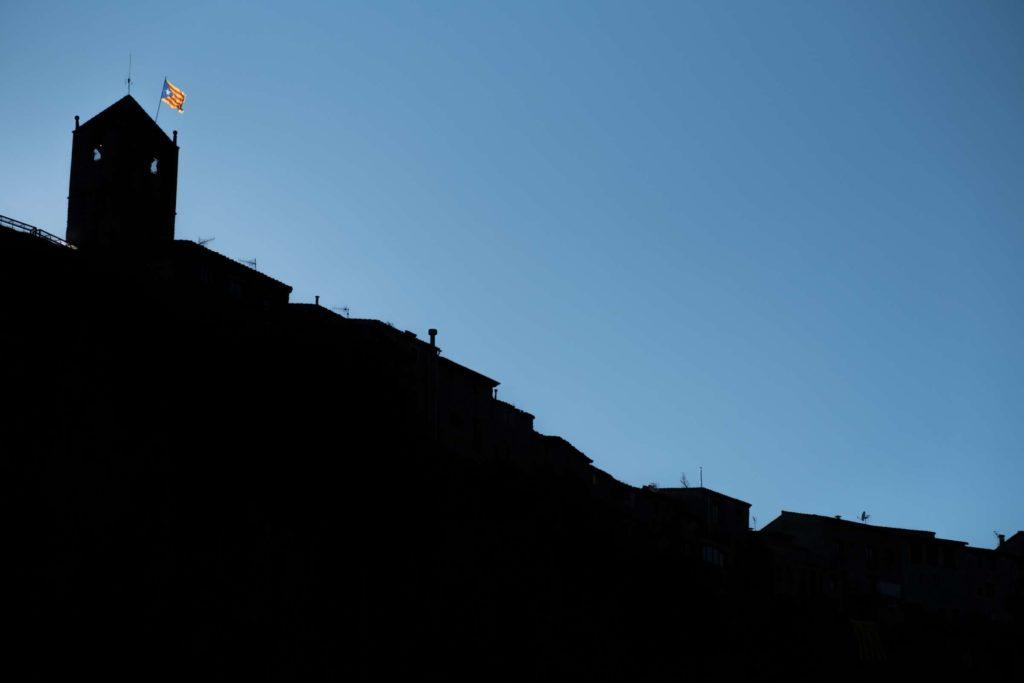 Castellfollit de la roca silhouette with Catalonia flag waving
