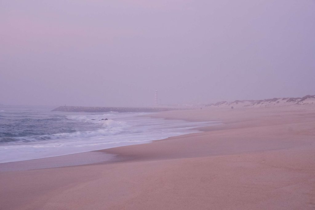 Costa Nova beach with pink mist after sunset