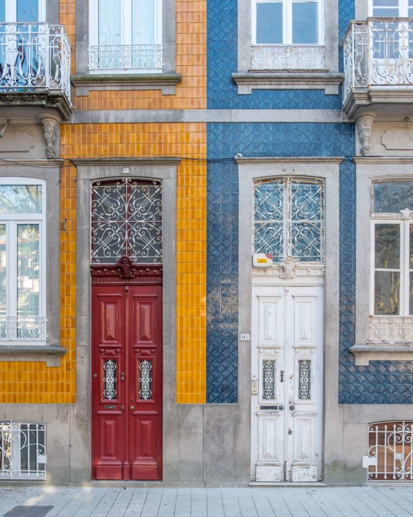 Pretty houses with symmetrical contrasting tiles in Porto