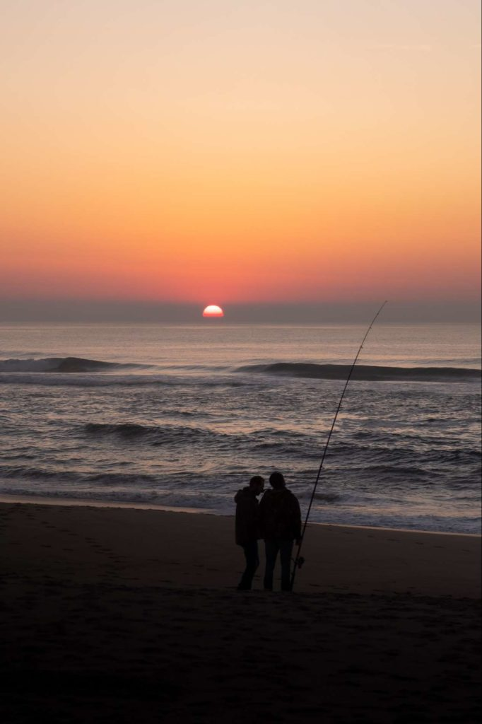 Silhouettes of fisherman on Praia da Costa Nova