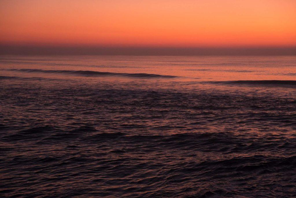 Sunset reflecting in the sea at Costa Nova beach