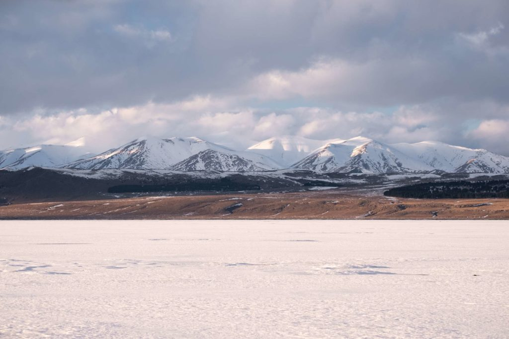 Tsalka reservoir with snowy mountains in the background