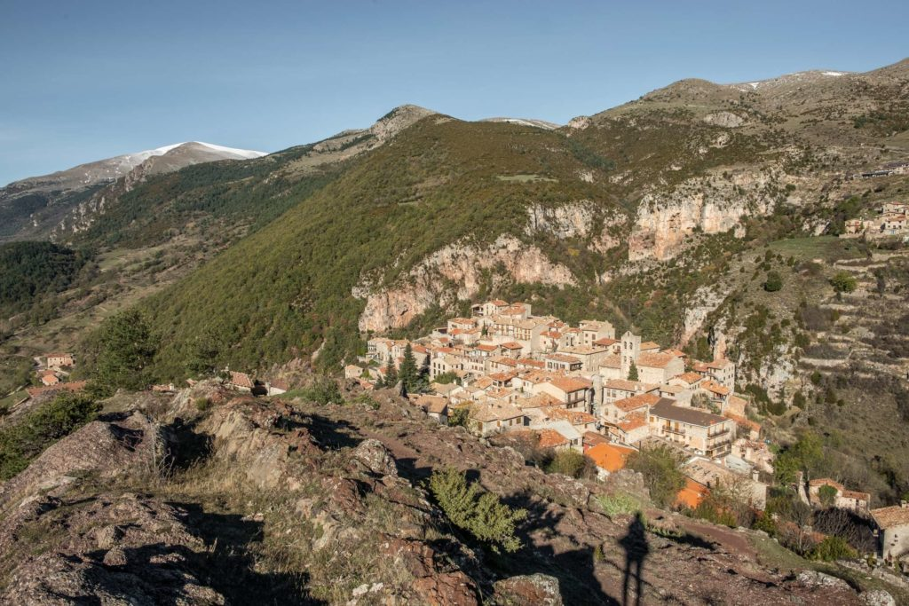 View over Castellar de n'Hug and the surrounding mountains, snowy peaks in the background