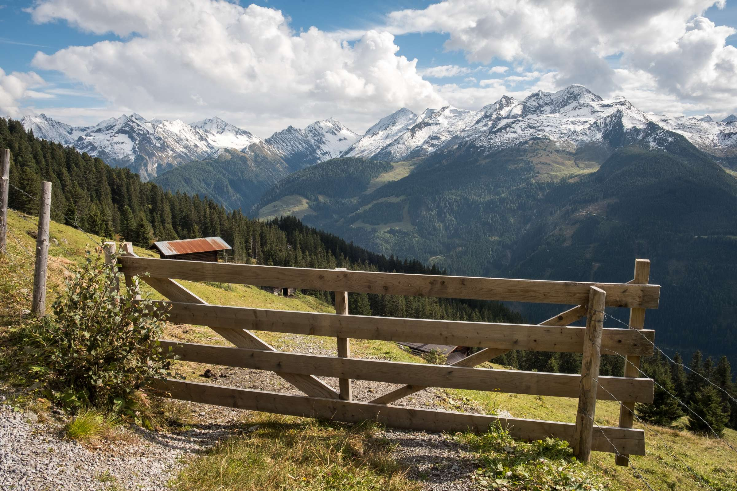 Mountain views with a cute wooden gate with towering mountains behind
