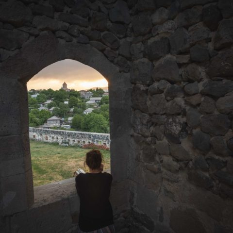 View from Rabati Castle through a window on Akhaltsikhe, Samtskhe-Javakheti, with Caroline in front