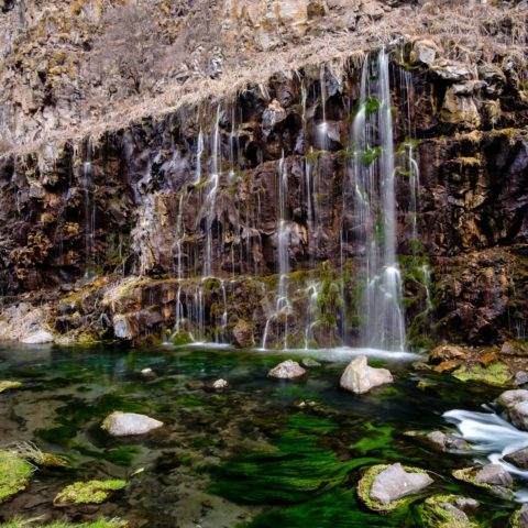 Another angle of Dashbashi waterfalls with green mossy water