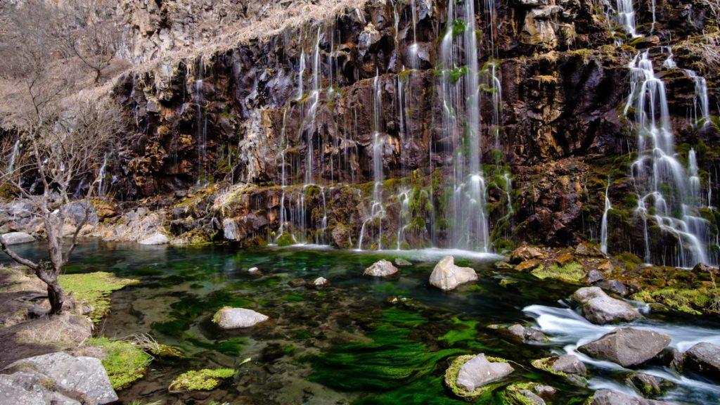 Dashbashi waterfalls with green mossy water