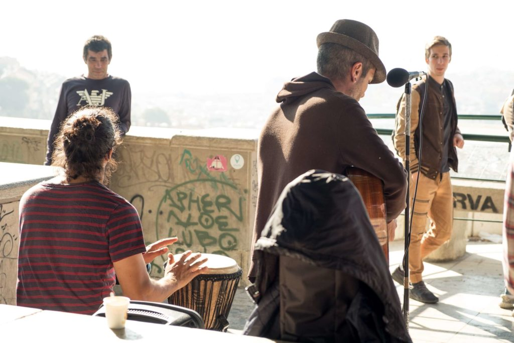 Band playing with audience at Miradouro da Graca viewpoint