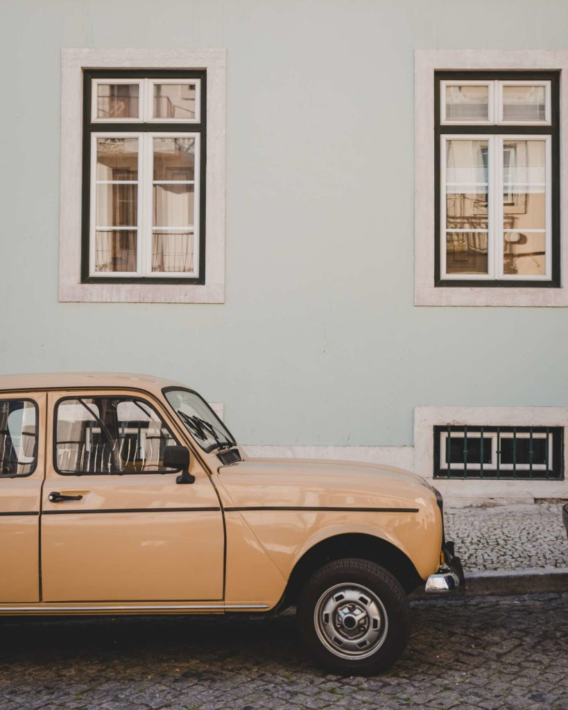 Old mini in front of pretty house in Lisbon