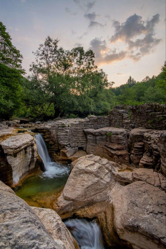 Small waterfall and rock formations behind Kinchkha waterfall