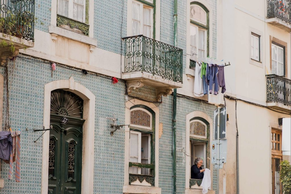 Woman hanging her washing out of her apartment window